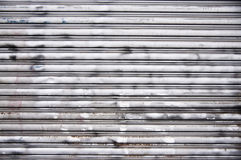 Steel Garage Door. A nice steel garage door background texture. Complete with rust spots, spray paint, scratches and dings Stock Images