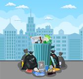 Steel garbage bin full of trash. Stock Image