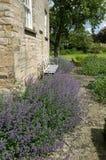 Steel Garden Seat - Flower Border-UK Stock Image