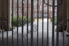 Steel gate into classic courtyard royalty free stock photography