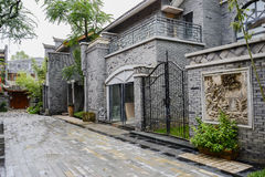 Steel gate of old-fashioned Chinese building after rain Royalty Free Stock Photography