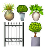 A steel gate and potted plants Royalty Free Stock Photo