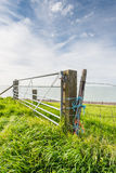 Steel gate and wooden beams on a dike Royalty Free Stock Images