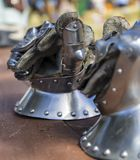 Steel Gauntlets. Knights steel gauntlets on wooden table Royalty Free Stock Photography