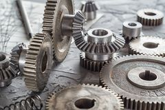 Steel gear and reducer, engineering details. Metal cogwheels. Industry Concept Royalty Free Stock Photography