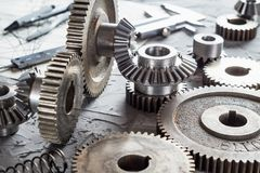 Steel gear and reducer, engineering details. Metal cogwheels. Industry Concept Royalty Free Stock Photos