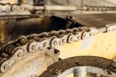 Steel gear wheel with chain drive of a boom mobile platform truck. Chain transmission. Limited depth of field Stock Images