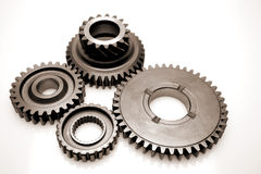 Steel gears. Four steel gears over white Royalty Free Stock Images