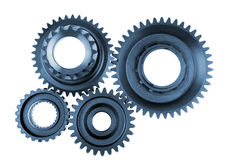 Steel gears. Meshing together over white Stock Photos