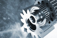 Steel gears against titanium background Stock Photos