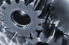 Steel gears in blue Stock Images