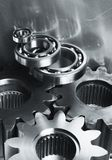 Steel gears in silver toning Stock Photos