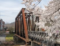 Steel girder bridge carries the bike walking trail over Deckers Creek Morgantown royalty free stock image