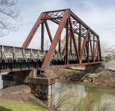 Steel girder bridge carries the bike walking trail over Deckers Creek Morgantown stock images