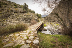 Steel girder and stone bridge in the hills of Corsica Royalty Free Stock Images