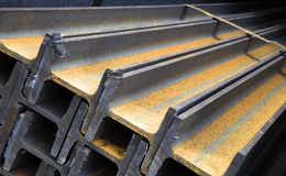 Steel girders. Pile of interlocking steel girders with yellow markings Royalty Free Stock Photography
