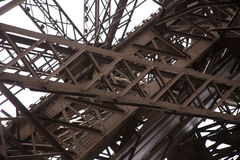 Steel girders of Eiffel Tower. Details of massive, interlaced steel girders that support the famous Eiffel Tower, Paris, France Stock Photography