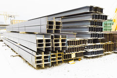Steel girders in outdoor warehouse Stock Photos