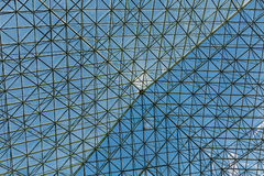 Steel and Glass Atrium Roof Under Blue Sky Stock Image