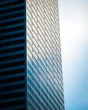 Steel and glass building and cloudy sky Stock Photo