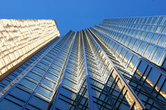 Steel and Glass - Day. Steel and glass of a modern skyscraper reflecting the sunshine Royalty Free Stock Image