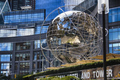 Steel globe. At Manhattan with blue windows of sckyscrapers on the backgound Royalty Free Stock Photography