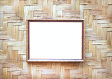 Steel gold picture frame decorative hanging on wood woven wall background royalty free stock photo