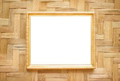 Steel gold picture frame decorative hanging on wood woven wall background royalty free stock photos