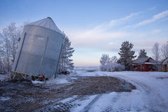 Steel grain bin tipping over Royalty Free Stock Photos