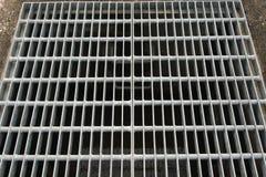 Steel grating. Above concrete manhoe Stock Image