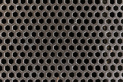Steel grating covering sewer Stock Photography