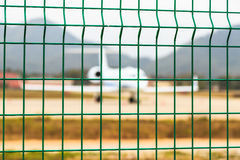 Steel Grating Fence of Airport, Laos Royalty Free Stock Image