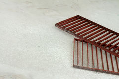 Steel grating red on a white background. Royalty Free Stock Photos