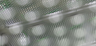Steel grating texture bokeh. Background royalty free stock photo
