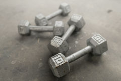 Steel gray weights on gym floor. Steel gray weights on gym floor Royalty Free Stock Image