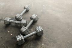 Steel gray weights on gym floor. Steel gray weights on gym floor Stock Photos