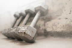 Steel gray weights on gym floor Royalty Free Stock Image