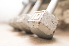 Steel gray weights on gym floor Royalty Free Stock Photos