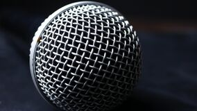 Steel grille background. Close-up shot of microphone.  stock video