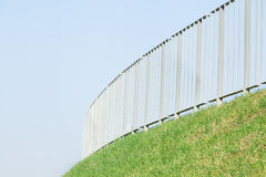 Steel guard with green grass Royalty Free Stock Photography