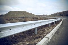 Steel guard rail barrier on the motorway. Without reflective sign royalty free stock image