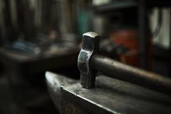 Steel hammer on anvil Stock Images