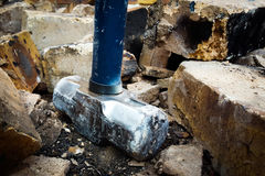 Steel Hammer Demolish Bricks. Steel Silver Blue Hammer that demolish and break down brick wall brown and concrete. Broken Pieces. Chunks of Bricks. Crumble down Stock Photography