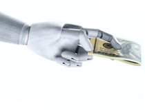 A steel hand with dollars Royalty Free Stock Photos