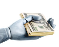 A steel hand with dollars Stock Photo
