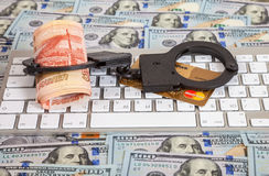 Steel handcuffs, credit card and roll of russian rubles lying on Stock Photography