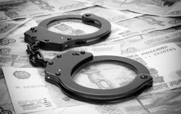 Steel handcuffs and money Royalty Free Stock Image