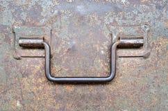 Steel handle on old steel door Stock Photo