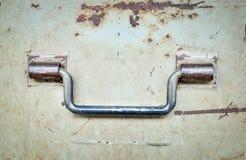 Steel handle on old steel door Stock Images