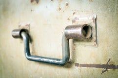 Steel handle on old steel door Royalty Free Stock Photo